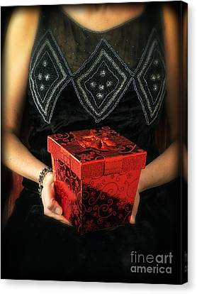 Mysterious Woman With Red Box Canvas Print by Edward Fielding