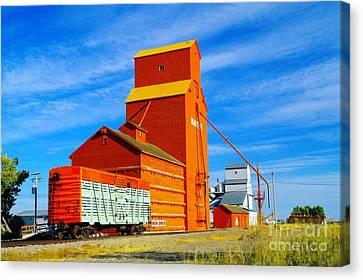 Nanton Grain Elevators  Canvas Print by Jeff Swan
