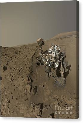 Nasas Curiosity Mars Rover On Planet Canvas Print by Stocktrek Images