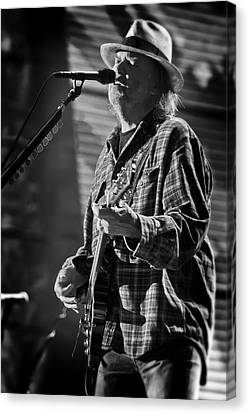 Neil Young Singing And Playing Guitar In Black And White Canvas Print by Jennifer Rondinelli Reilly - Fine Art Photography