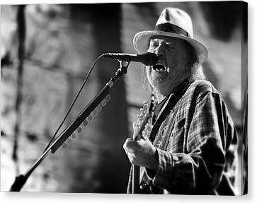 Neil Young Performing At Farm Aid In Black And White Canvas Print by Jennifer Rondinelli Reilly - Fine Art Photography