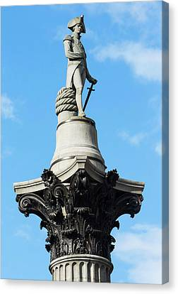 Nelson's Column Statue Canvas Print by Mark Thomas