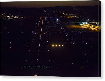 Night Landing At Portand International Canvas Print by Dave Cleaveland