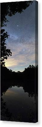 Night Sky Over A Lake Canvas Print by Laurent Laveder