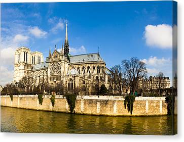 Notre Dame De Paris And The River Seine Canvas Print by Mark E Tisdale