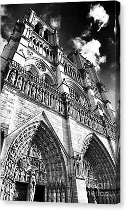 Notre Dame De Paris Canvas Print by John Rizzuto