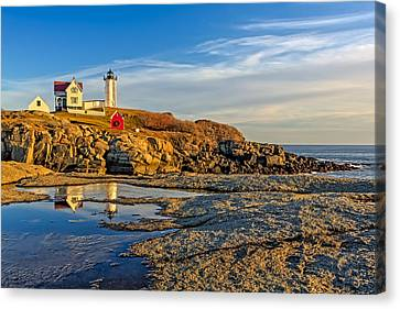 Nubble Lighthouse Reflections Canvas Print by Susan Candelario