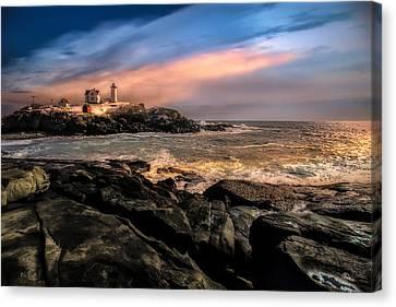 Nubble Lighthouse Winter Solstice Sunset Canvas Print by Bob Orsillo