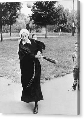 Nun Swinging A Baseball Bat Canvas Print by Underwood Archives