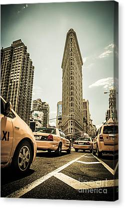 Nyc Yellow Cabs At The Flat Iron Building - V1 Canvas Print by Hannes Cmarits