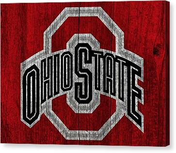 Ohio State University On Worn Wood Canvas Print by Dan Sproul