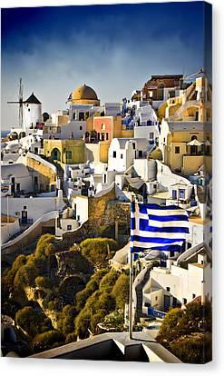Oia And A Greek Flag Canvas Print by Meirion Matthias