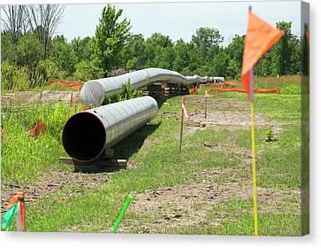 Oil Pipeline Construction Canvas Print by Jim West