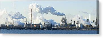 Oil Refinery At The Waterfront Canvas Print by Panoramic Images