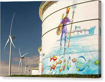 Oil Terminal And Wind Turbines Canvas Print by Ashley Cooper
