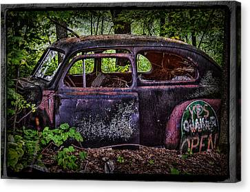 Old Abandoned Car In The Woods Canvas Print by Paul Freidlund
