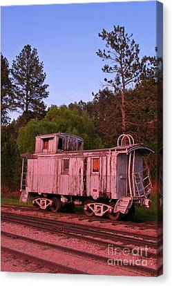 Old And Weathered Caboose Canvas Print by John Malone