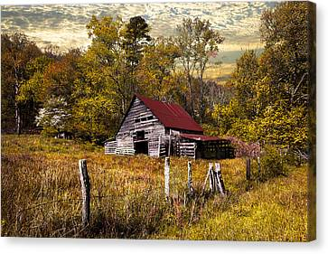 Old Barn In Autumn Canvas Print by Debra and Dave Vanderlaan