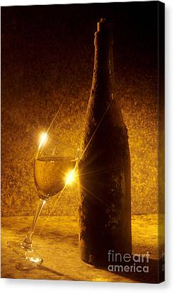 Old Bottle Of  Wine With A Glass Canvas Print by Bernard Jaubert