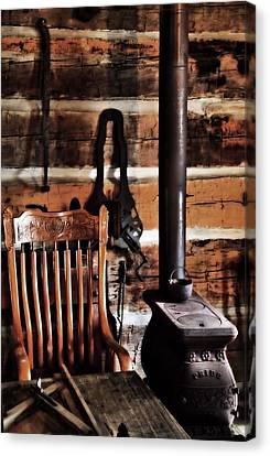 Old Cabin And Wood Burning Stove Canvas Print by Dan Sproul