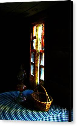 Old Cabin Table With Lamp And Basket Canvas Print by Julie Dant