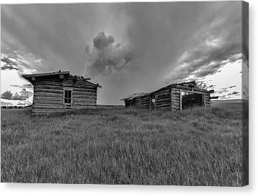 Old Cabins Resting Canvas Print by Stellina Giannitsi