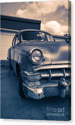 Old Car In Front Of Garage Canvas Print by Edward Fielding
