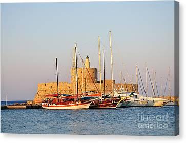 Agios Nikolaos Lighthouse At The Old City Of Rhodes Canvas Print by George Atsametakis