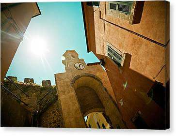 Old Clock On The Tower And Sun Canvas Print by Raimond Klavins