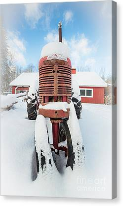 Old Farm Tractor In The Snow Canvas Print by Edward Fielding