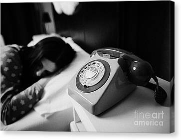 Old Fashioned Gpo Bt Phone On Bedside Table Of Early Twenties Woman In Bed In A Bedroom Canvas Print by Joe Fox