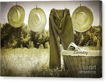 Old Grunge Photo Of Jeans And Straw Hats  Canvas Print by Sandra Cunningham