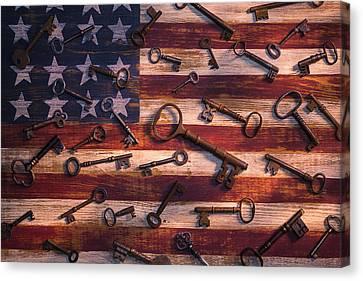Old Keys On American Flag Canvas Print by Garry Gay