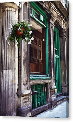 Old Montreal Architecture Canvas Print by John Rizzuto