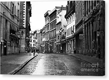 Old Montreal Streets Canvas Print by John Rizzuto