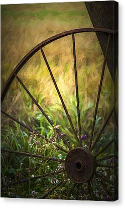 Old Rusty Wheel Canvas Print by Erik Brede
