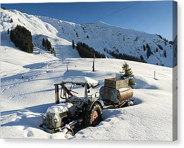 Old Tractor In Winter With Lots Of Snow Waiting For Spring Canvas Print by Matthias Hauser