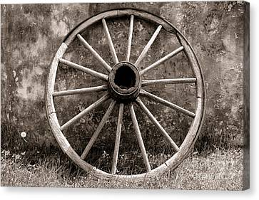 Old Wagon Wheel Canvas Print by Olivier Le Queinec
