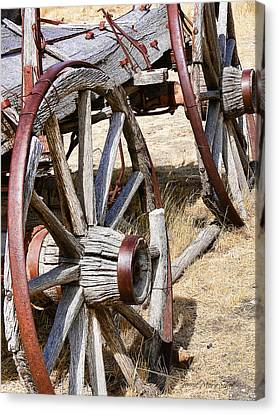 Old Wagon Wheels From Montana Canvas Print by Jennie Marie Schell