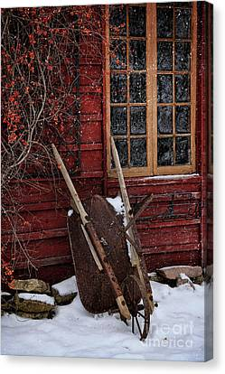 Old Wheelbarrow Leaning Against Barn In Winter Canvas Print by Sandra Cunningham
