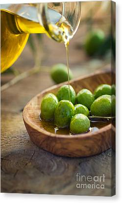 Olive Oil Canvas Print by Mythja  Photography