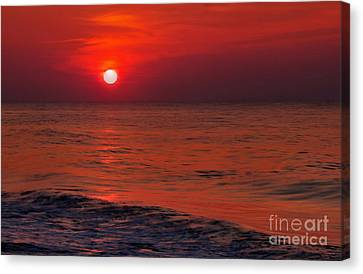 Orange Sunset Canvas Print by Jeff Breiman