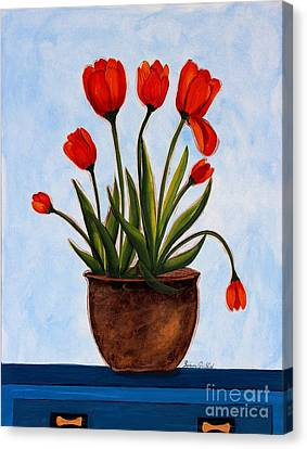Orange Tulips On A Blue Buffet Canvas Print by Barbara Griffin