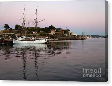Oslo Harbor At Sunset Canvas Print by Carol Groenen