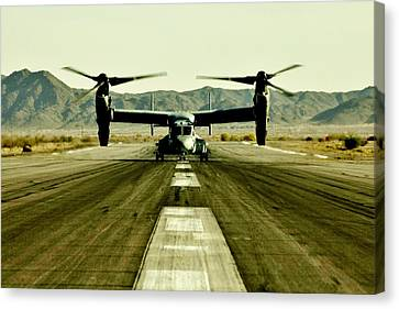 Osprey Takeoff Canvas Print by Benjamin Yeager