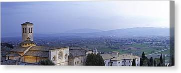 Panoramic View Of Assisi At Night Canvas Print by Susan  Schmitz
