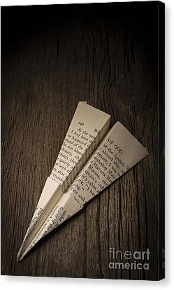Paper Airplane From Old Book Page Canvas Print by Edward Fielding