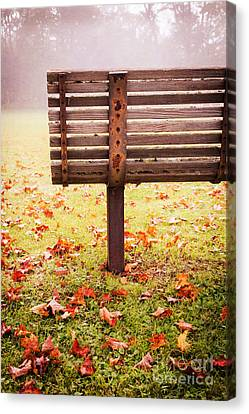 Park Bench In Autumn Canvas Print by Edward Fielding