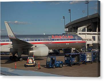 Passenger Airliner At An Airport Canvas Print by Jim West