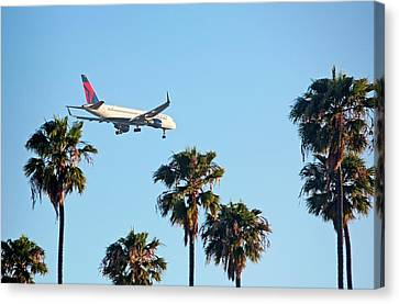 Passenger Jet Airliner Landing Canvas Print by Jim West
